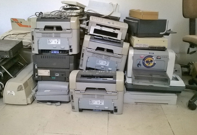 Old printers being prepared for the tip